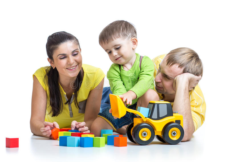 Child boy with parents play building blocks royalty free stock images