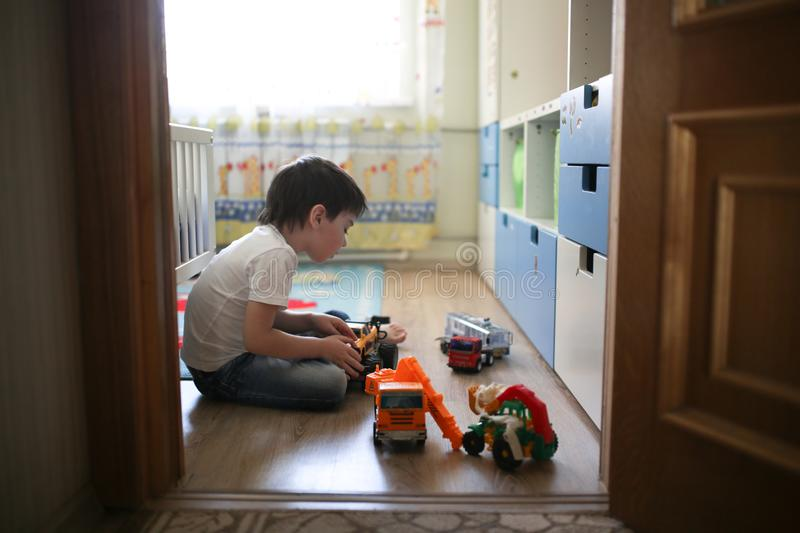 Boy playing alone in the room, loneliness royalty free stock image