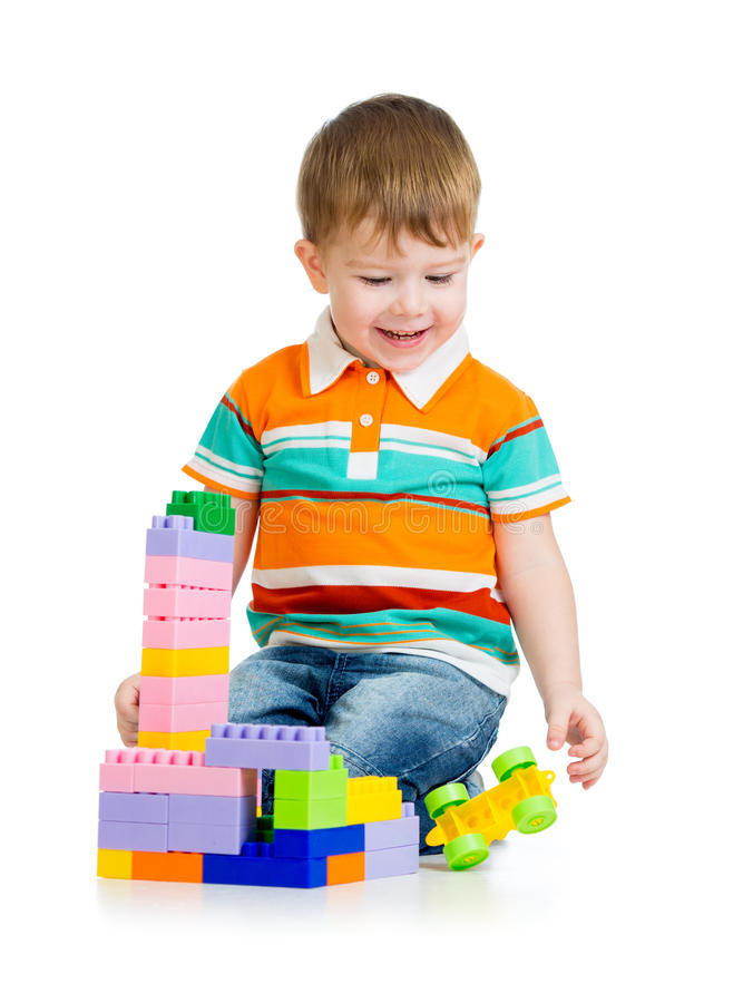 Boy Toys Background : Child boy playing with toys over white background stock