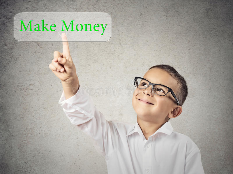 Child boy pressing make money button on touchscreen stock images