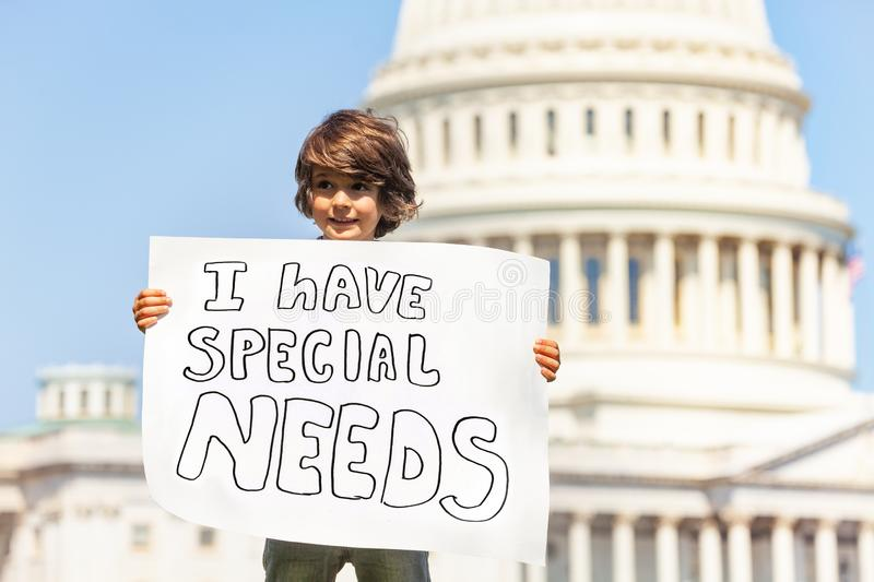 Protester boy holding sign I have special needs stock photo