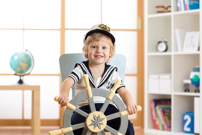 Child boy in sailor hat - adventure and travel concept. Child toddler boy in sailor hat - adventure and travel concept stock photography