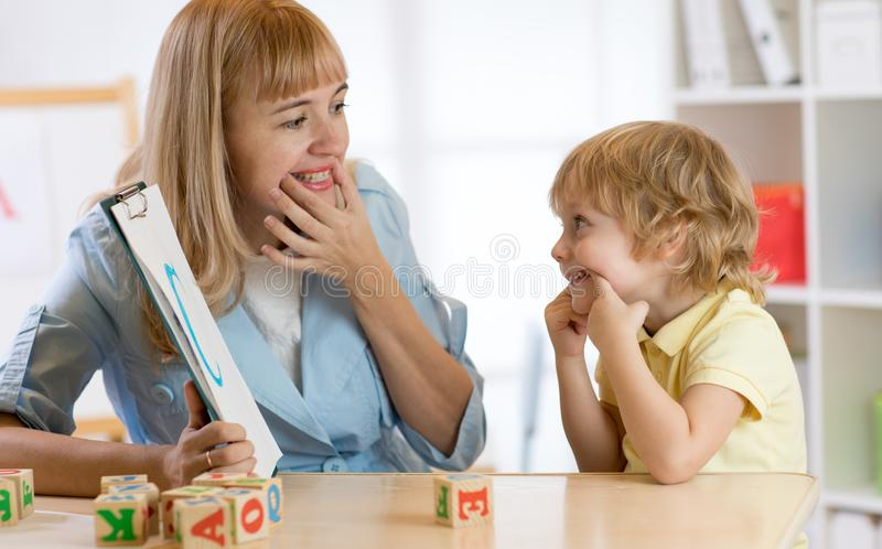 Child boy at speech therapist office. Cute child boy at speech therapist office stock images