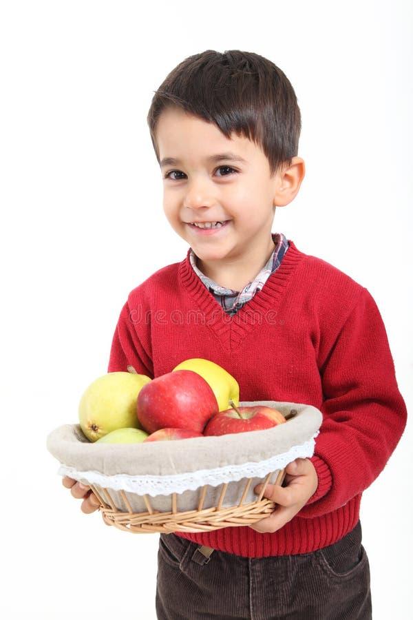 Child bring basket fruit stock photography