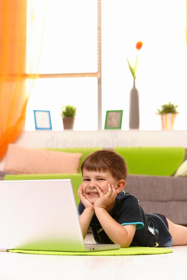 Child browsing internet computer at home stock photo