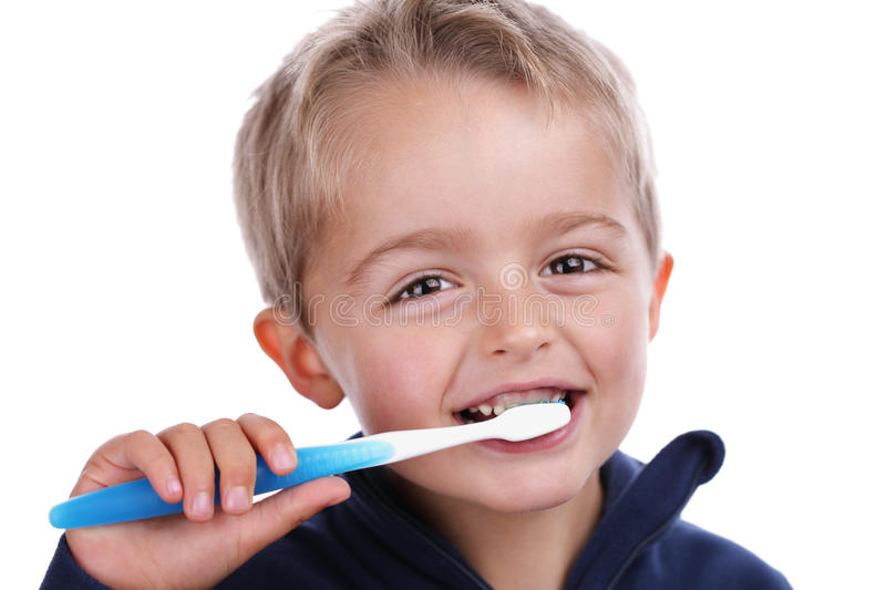 Child brushing teeth royalty free stock photography