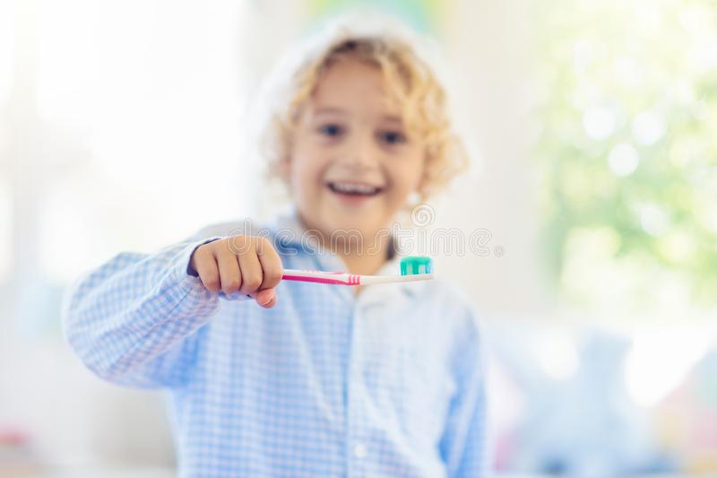 Child brushing teeth. Kids with toothpaste, brush. Child brushing teeth. Kids with toothpaste and brush. Dental and oral hygiene, care. Healthy daily routine for stock photos