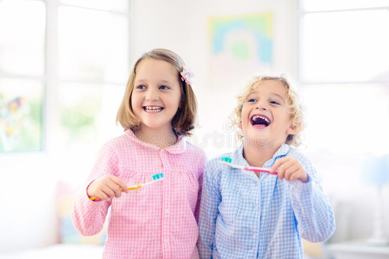 Child brushing teeth. Kids with toothpaste, brush. Child brushing teeth. Kids with toothpaste and brush. Dental and oral hygiene, care. Healthy daily routine for royalty free stock images