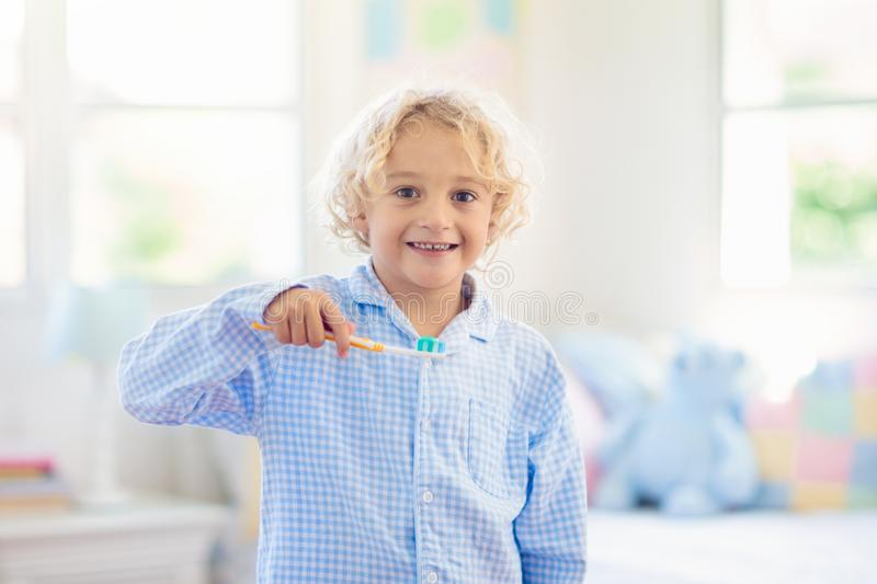 Child brushing teeth. Kids with toothpaste, brush. Child brushing teeth. Kids with toothpaste and brush. Dental and oral hygiene, care. Healthy daily routine for royalty free stock photos