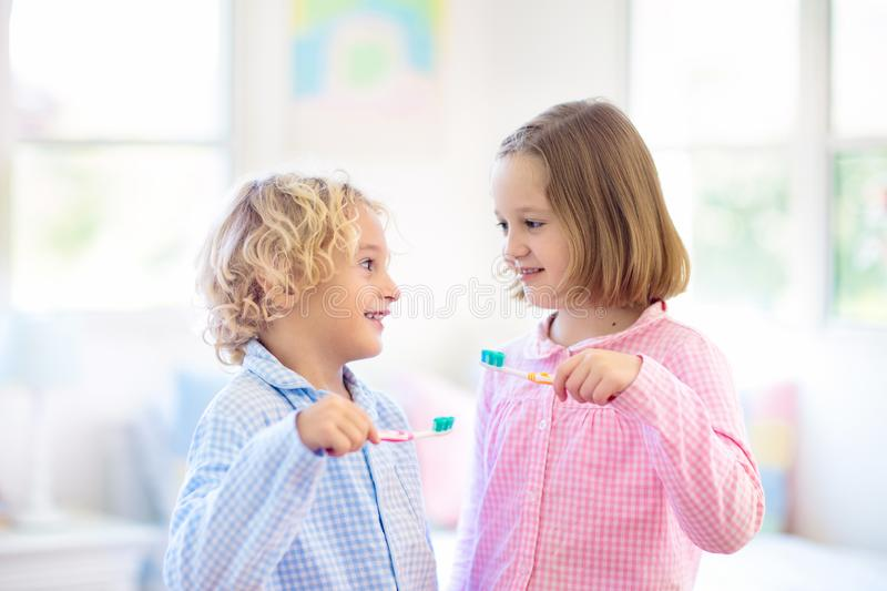 Child brushing teeth. Kids with toothpaste, brush. Child brushing teeth. Kids with toothpaste and brush. Dental and oral hygiene, care. Healthy daily routine for stock image
