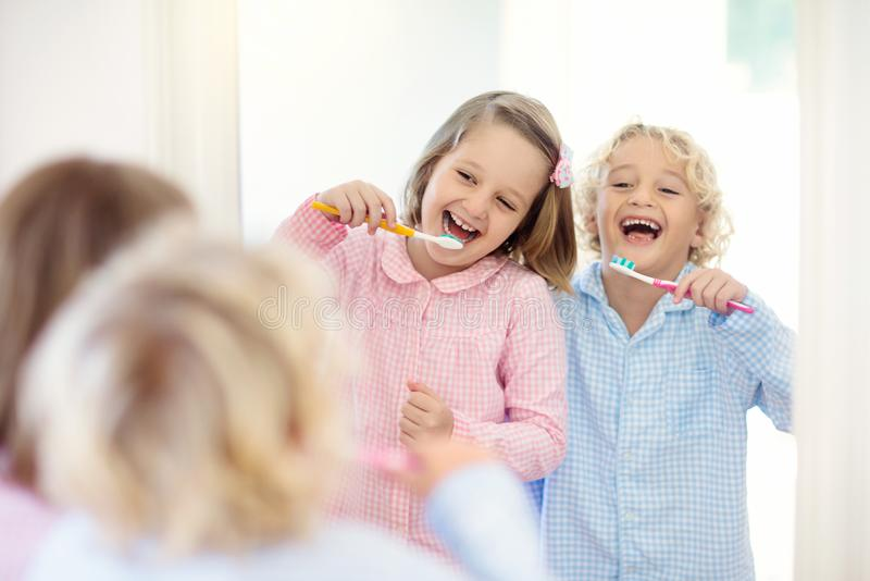 Child brushing teeth. Kids with toothpaste, brush. Child brushing teeth. Kids with toothpaste and brush. Dental and oral hygiene, care. Healthy daily routine for stock photo