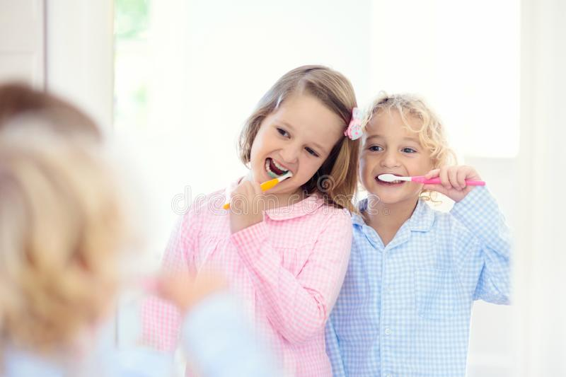 Child brushing teeth. Kids with toothpaste, brush. Child brushing teeth. Kids with toothpaste and brush. Dental and oral hygiene, care. Healthy daily routine for stock images