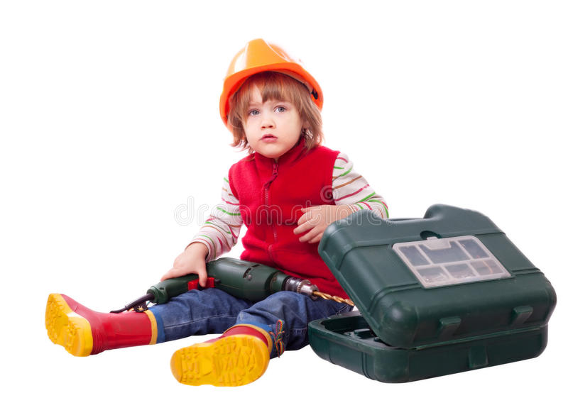 Child in builder hard hat with tools stock images