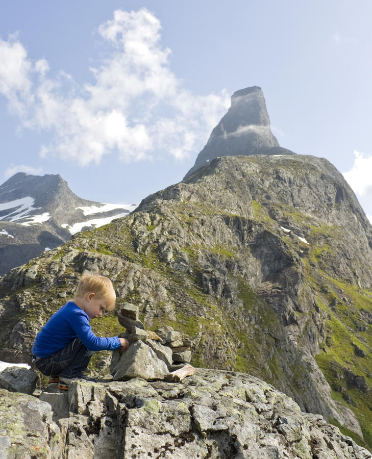 Child building a cairn