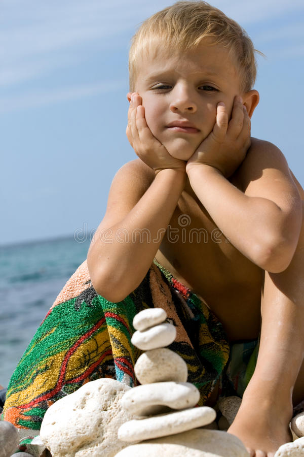 Download Child Building Pyramid From Pebble. Stock Photo - Image: 13556054