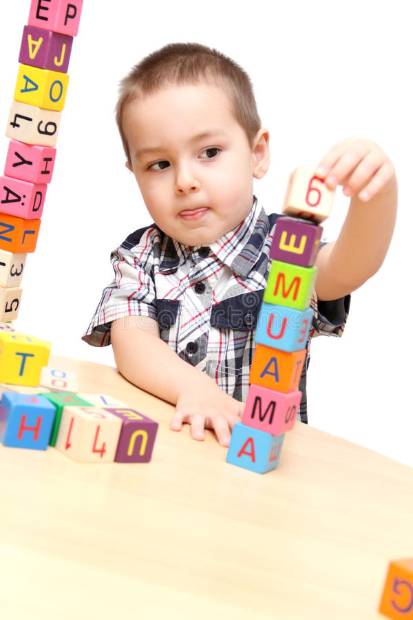 Child building a tower stock images