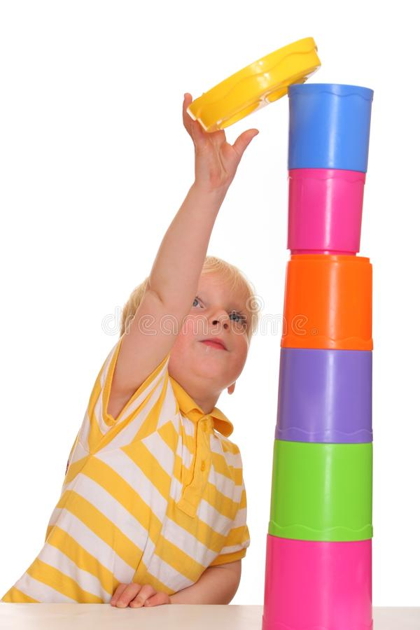 Download Child Builds Stacking Tower Stock Photo - Image: 15390680