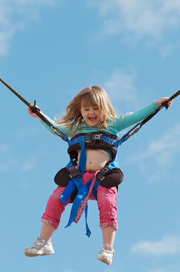 Child on bungee trampoline stock photo