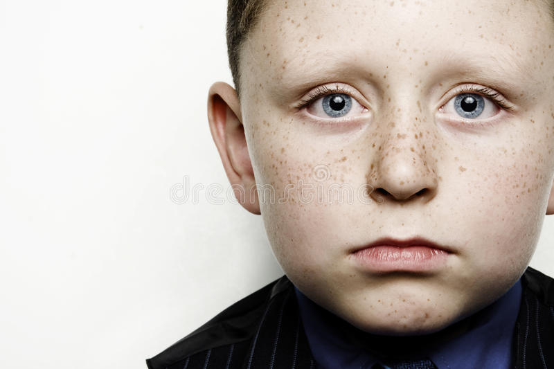 Child in Business Suit. A child in a blue business suit stock photo