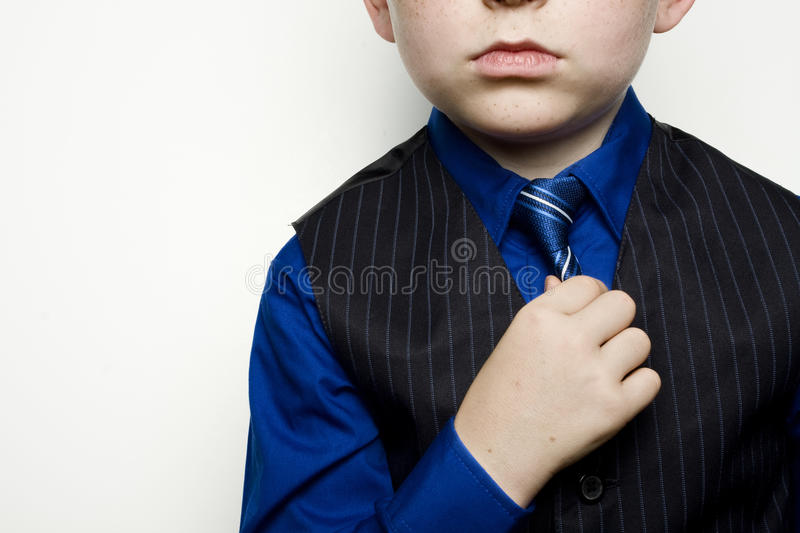 Child in Business Suit Adjusting Tie stock images