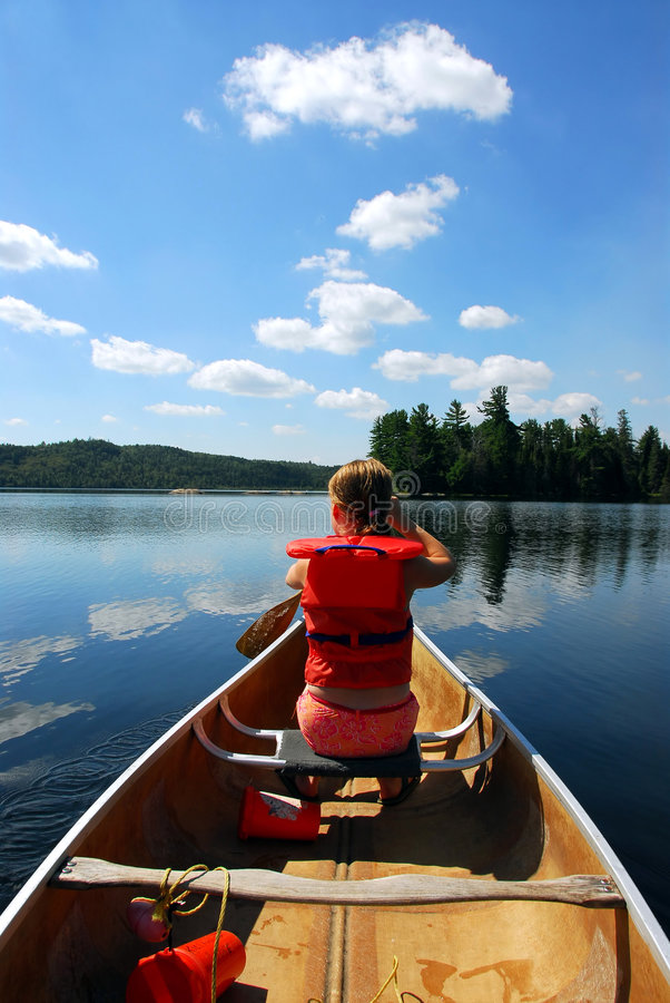 Child in canoe royalty free stock image