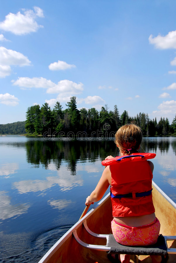 Child in canoe royalty free stock photo
