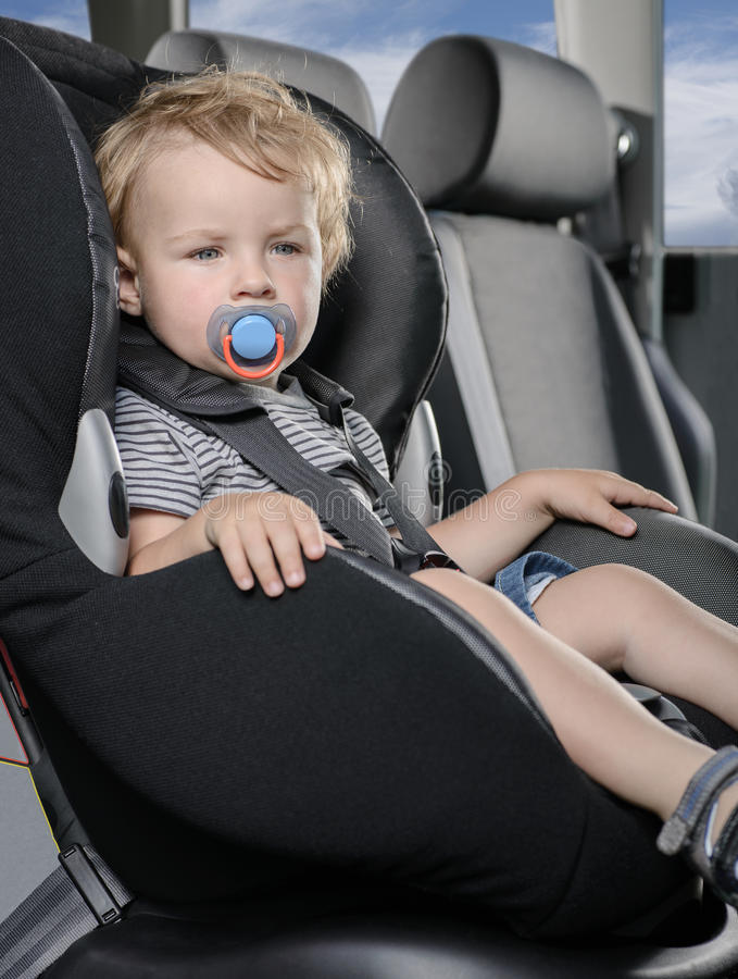 Child car seat. Kid sitting in a car baby child safety seat stock photo