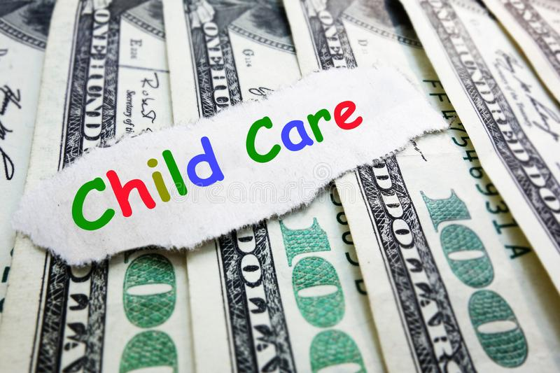 Child care cost. Child Care text in colorful letters on money -- cost of daycare concept royalty free stock photography