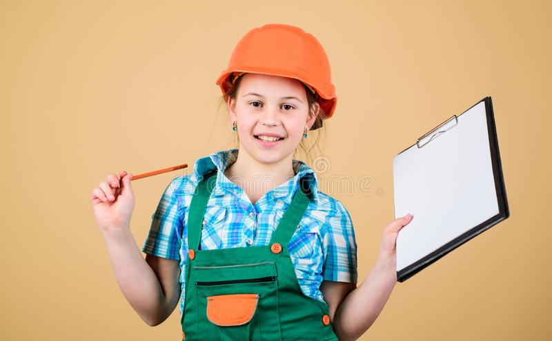 Child care development. Build your future yourself. Initiative child girl hard hat builder worker. Safety expert. Foreman inspector. Builder engineer architect royalty free stock photo