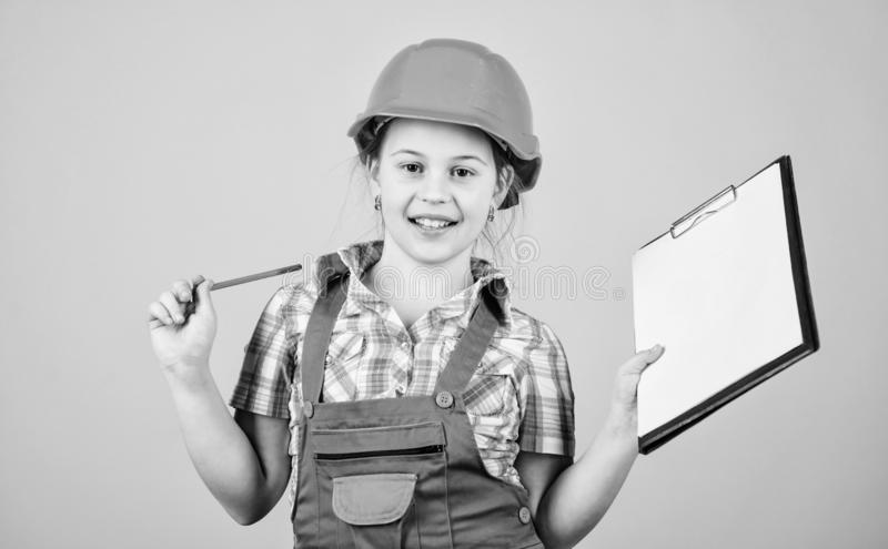Child care development. Build your future yourself. Initiative child girl hard hat builder worker. Safety expert stock images