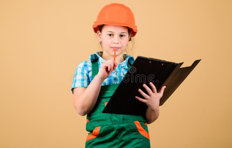 Child care development. Foreman inspector. Repair. Safety expert. Future profession. small girl repairing in workshop. Builder engineer architect. Kid worker stock photography