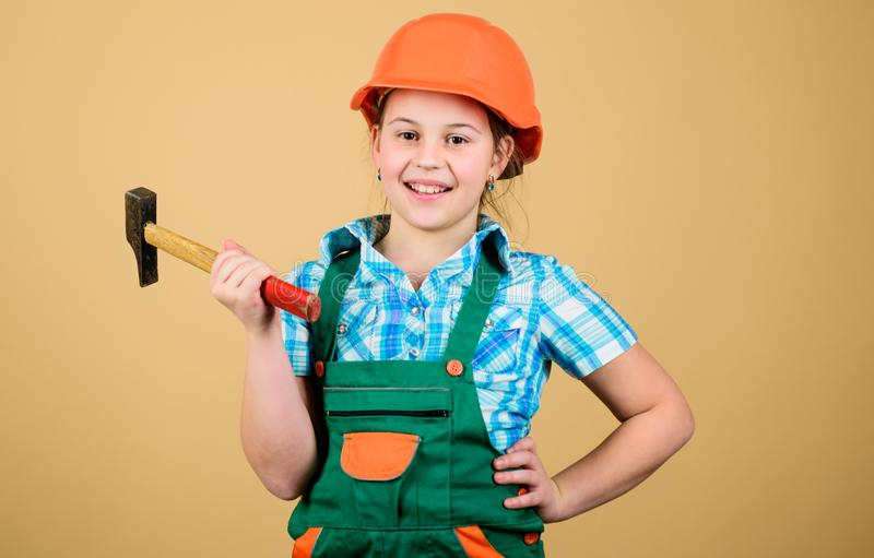 Child care development. Future profession. Builder engineer architect. Kid builder girl. Build your future yourself. Initiative child girl hard hat helmet royalty free stock photo