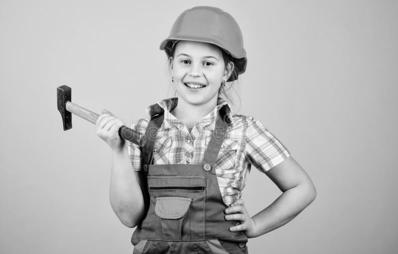 Child care development. Future profession. Builder engineer architect. Kid builder girl. Build your future yourself. Initiative child girl hard hat helmet stock image