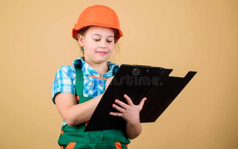 Child care development. Safety expert. Future profession. Foreman inspector. Repair. Builder engineer architect. Kid. Worker in hard hat. small girl repairing stock image