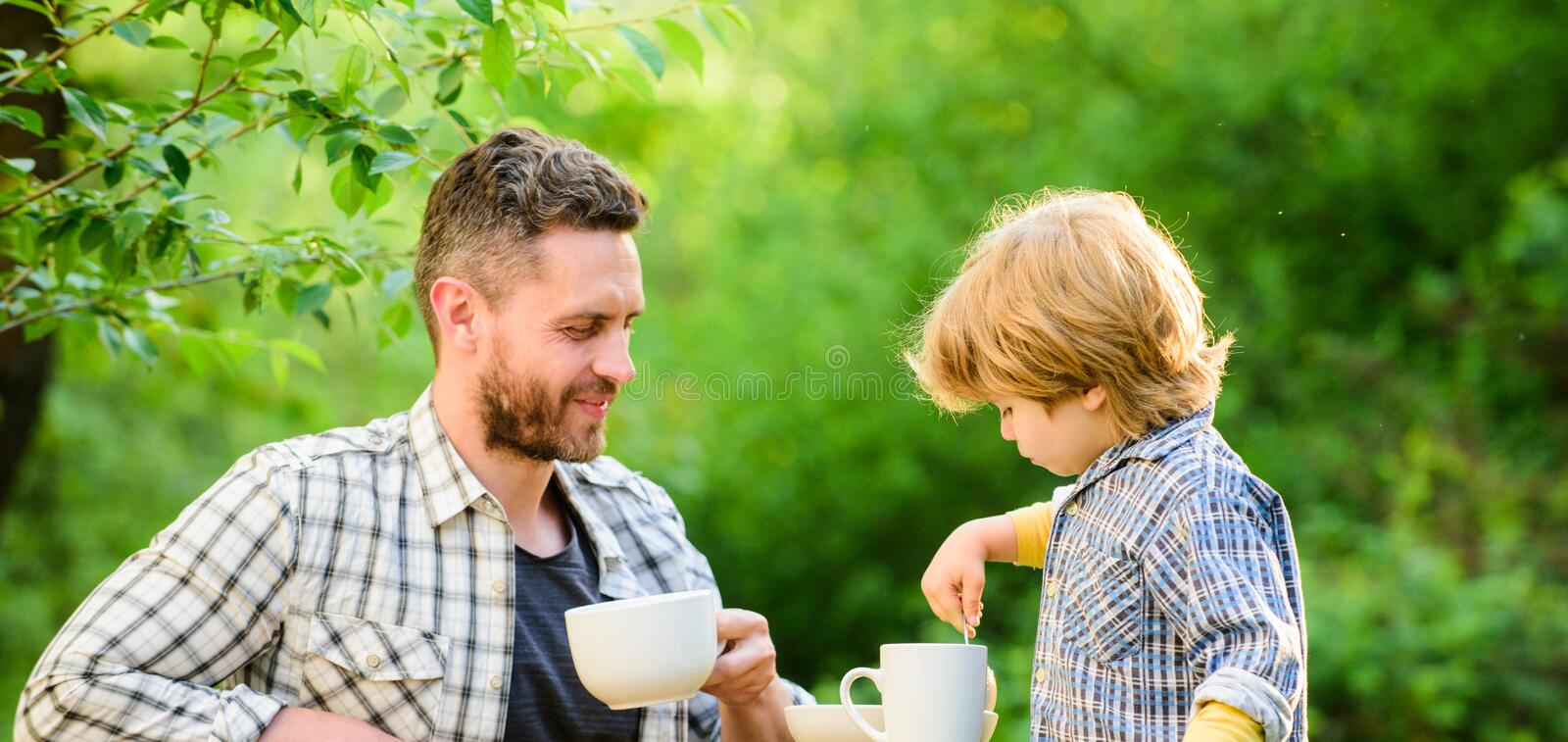Child care. Feeding son natural foods. Feed in right way for childs stage of development. Feed son solids. Feed your. Baby. Natural nutrition concept. Dad and stock images