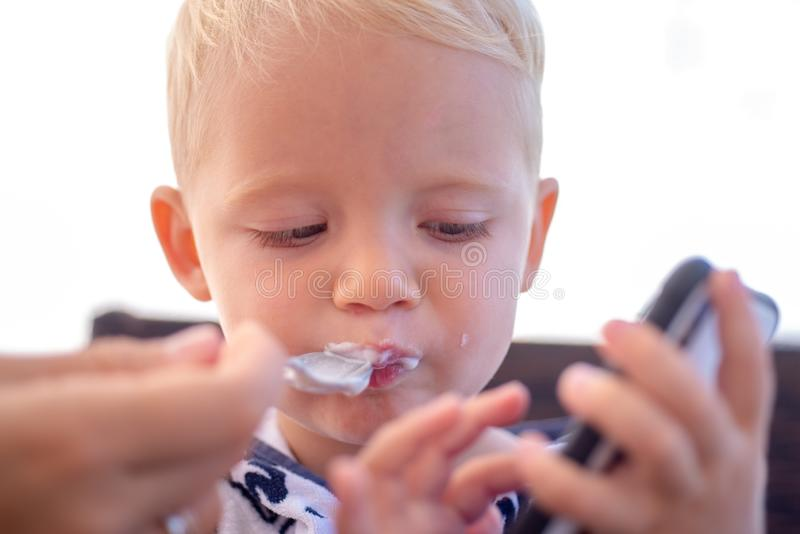 Child care. Tasty breakfast. Carefree child. Only fun is on my mind. Funny little boy. stock photo