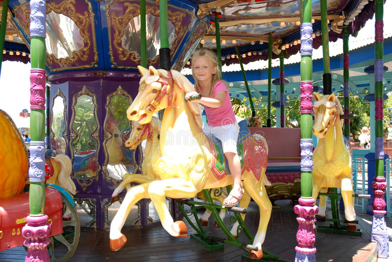 Child on carousel royalty free stock photography