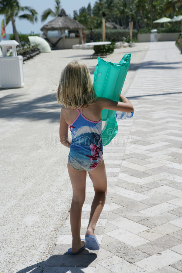 Child carrying inflatable toy royalty free stock photo