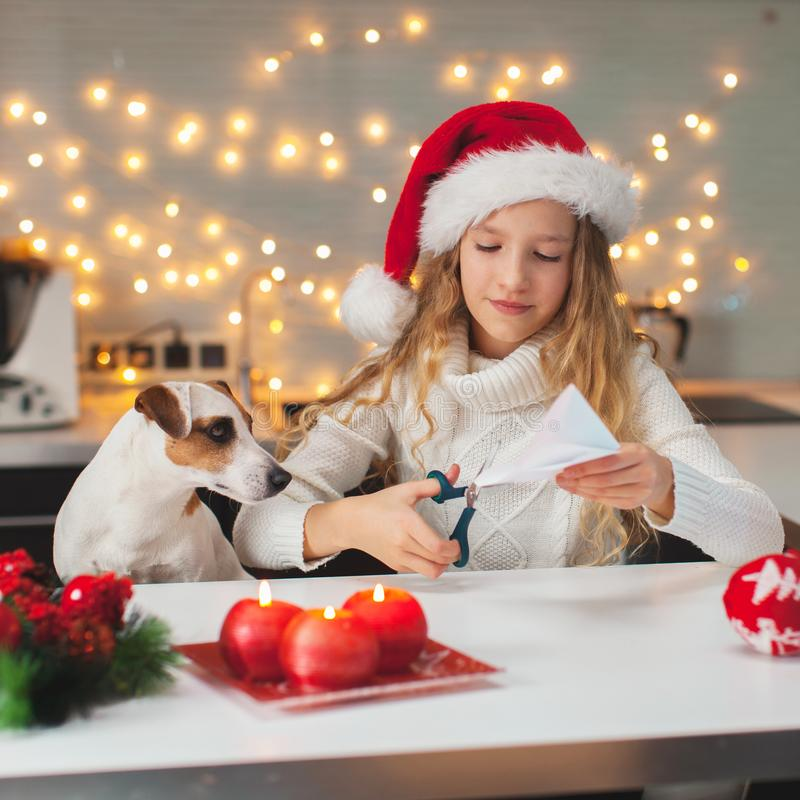 Child carves a snowflake for christmas stock photography