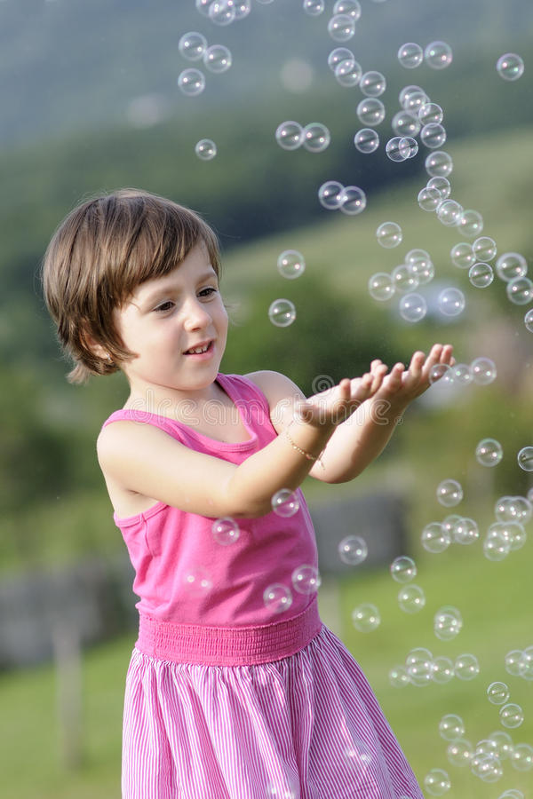 Download Child catching balloons stock photo. Image of recreation - 20322844