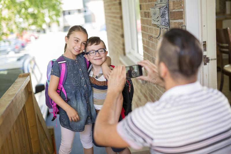 Child Caucasian leaves home for his first day at preschool stock images