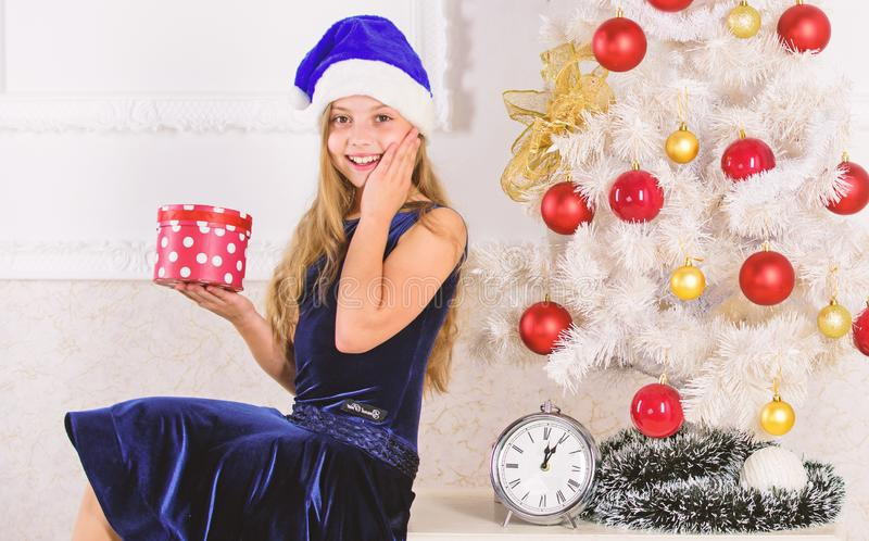 Child celebrate christmas at home. Time to open christmas gifts. Merry christmas concept. Best for kids. Kid girl near royalty free stock photo