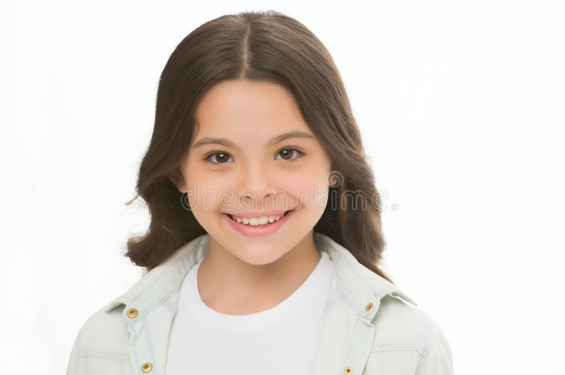 Child charming smile isolated white background close up. Charming cutie. Kid girl long curly hair posing cheerful happy royalty free stock images