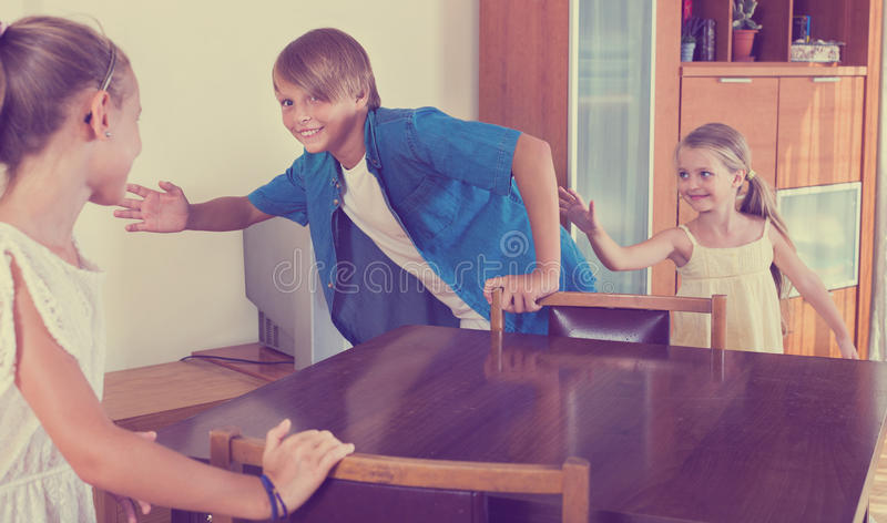 Child chasing other kids to tag or touch them stock photos