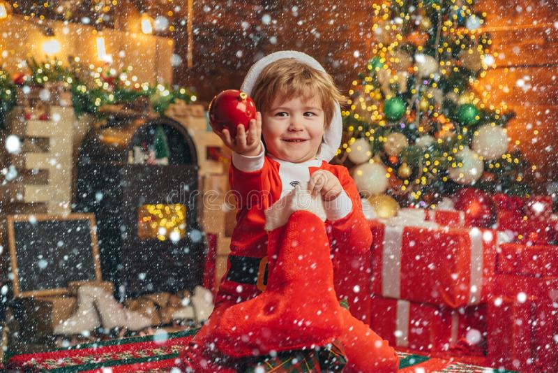 Child cheerful face got gift in christmas sock. Check contents of christmas stocking. Joy and happiness. Childhood royalty free stock photography
