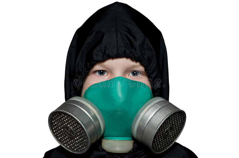 The child in the chemical protection suit. The photo before the boy in the chemical protection suit stock image