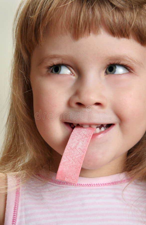 Child with chewing gum royalty free stock photo