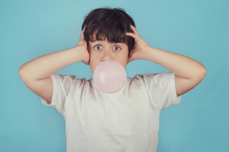 Child with chewing gum in your mouth royalty free stock photos