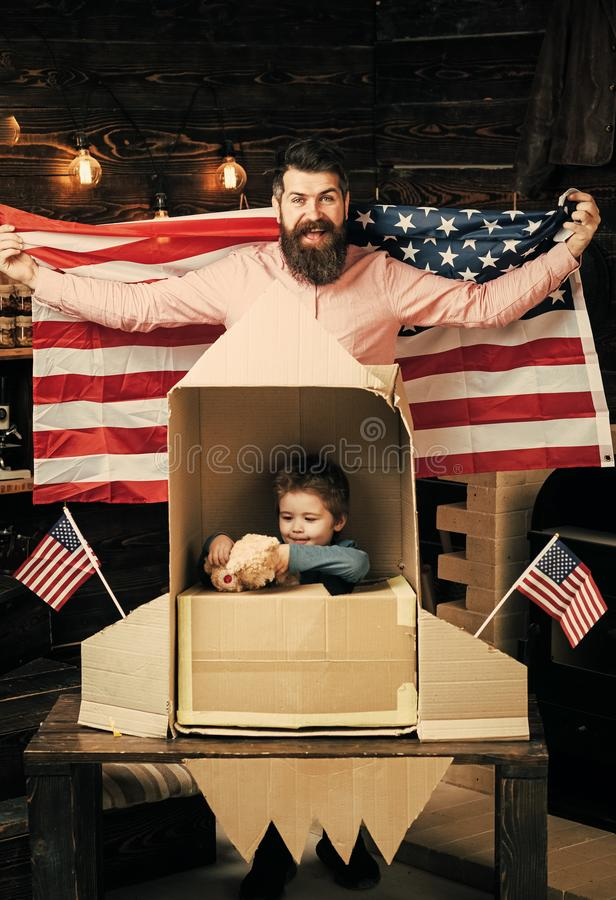 Child Childhood Children Happiness Concept. American cheerful family with usa flags play with rocket made out of stock photography
