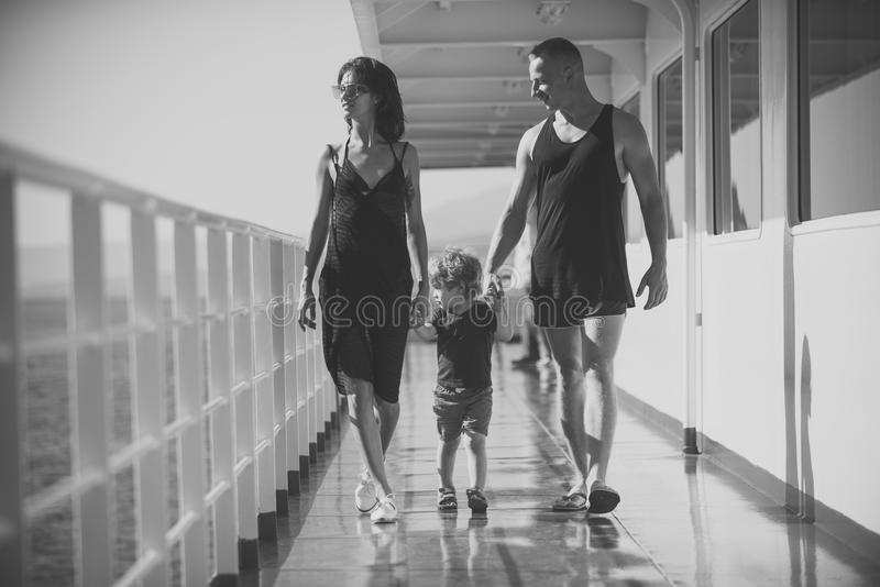 Child Childhood Children Happiness Concept. Family travelling on cruise ship on sunny day. Family rest concept. Father. Mother and child walk on deck of cruise royalty free stock photo